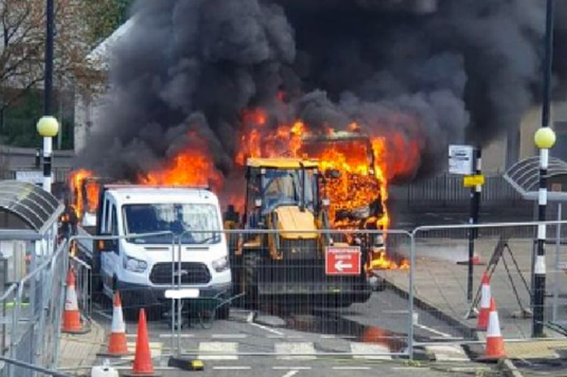 Explosions near shopping centre heard for miles as 'three vehicles set on fire'